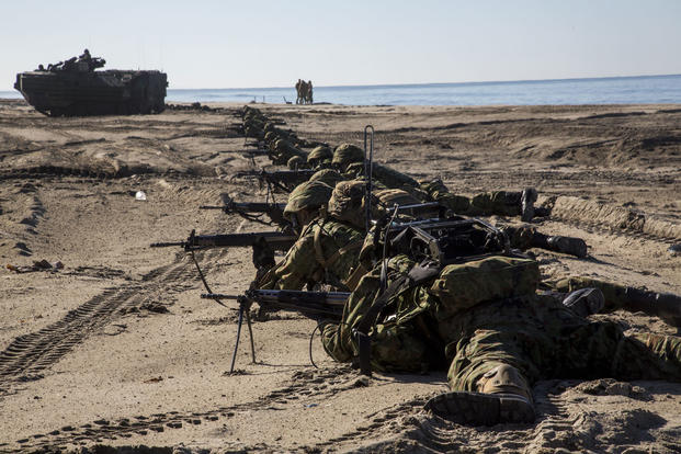 Japan Ground Self Defense Force soldiers set security after an amphibious landing, during Exercise Iron Fist 2017, aboard Marine Corps Base Camp Pendleton, Calif., Feb. 25, 2017. (U.S. Marine Corps Photo/Lance Cpl. Tyler Byther)