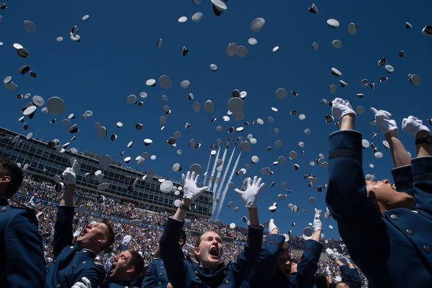 Class of 2017 Cadets are dismissed as the U.S. Air Force Thunderbirds in F-16 aircraft fly overhead during the U.S. Air Force Academy Graduation in Colorado Springs, Colo., May 24, 2017. (DoD Photo/U.S. Army Sgt. James K. McCann)