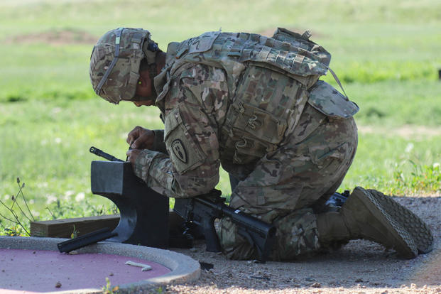 Sgt. Stephen Moreno, explosive ordnance disposal specialist with the 71st Ordnance Group (EOD), adjusts the sights on his M4 carbine during a zeroing lane at Fort Carson, Colorado, June 12, 2017. (U.S. Army photo/Spc. Anthony Bryant)