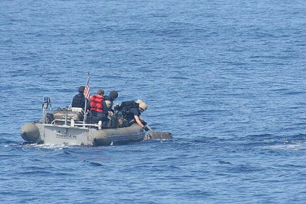 A small boat from the USS Princeton recovered a bale of drugs.