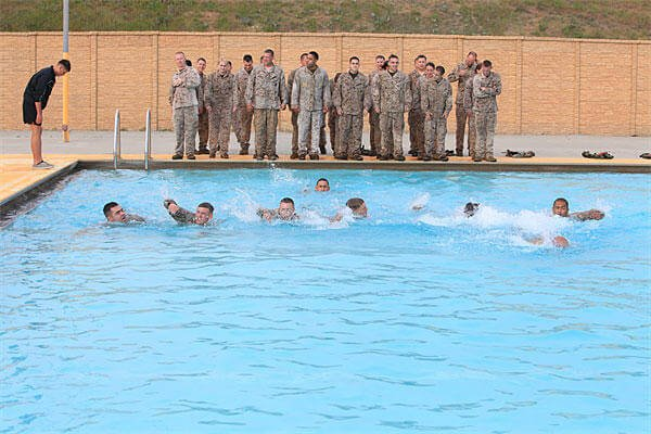 Marines with 9th Communication Battalion, I Marine Expeditionary Force, swim across the 43 Area Training Tank during swim qualification at Camp Pendleton. Joshua Young/Marine Corps