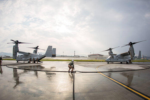 Marines with Marine Aerial Refueler Transport Squadron (VMGR) 152 MV-22B Osprey tiltrotor aircrafts during air delivery ground refueling training. (Cpl. Carlos Cruz Jr./U.S. Marine Corps)