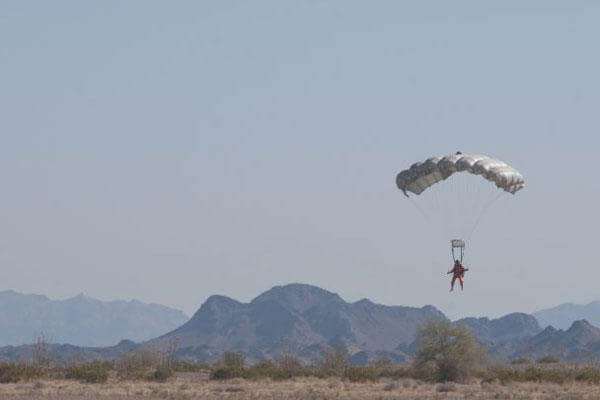 FILE PHOTO -- A Military Free Fall Parachutist Course student prepares to land in the Yuma, Ariz. desert during a training jump in April 2011. (Photo Credit: U.S. Army photo)