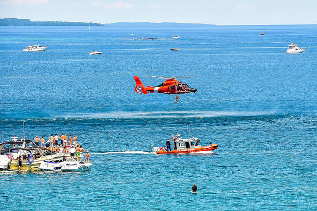 Crew from Coast Guard Air Station Traverse City, Mich., conduct hoist training with a 25-foot response boat in Lake Michigan, July 4, 2014. (U.S. Coast Guard photo courtesy of Air Station Traverse City)