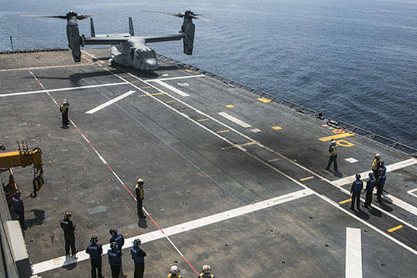 A U.S. Marine MV-22B Osprey lands on the Spanish amphibious assault ship Juan Carlos I (L-61) during deck landing qualifications, Sept. 9 near the coast of Spain. (U.S. Marine Corps/Staff Sgt. Vitaliy Rusavskiy)