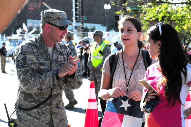 Master Sgt. Robert Hook, 113th Wing, D.C. Air National Guard, gives directions to an attendee at the 2015 Papal Visit in Washington, D.C., Sept. 23. (Air National Guard photo by Erica Rodriguez)