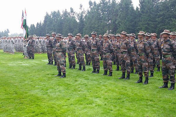 Soldiers from 1st Battalion, 23rd Infantry Regiment, 7th Infantry Division, and Indian Army troops with the Kumaon Regiment's 6th Battalion stand during the opening ceremony of Yudh Abhyas 15 at Joint Base Lewis-McChord Sept. 9. Sgt. Sinthia Rosario/Army