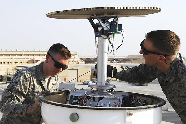 Staff Sgt. Gregory Evenson and Senior Airman David Baily, 386th Expeditionary Operations Support Squadron weather forecasters, conduct a preventative maintenance inspection on a Doppler radar system. (U.S. Air Force/Staff Sgt. Tyler Alexander)