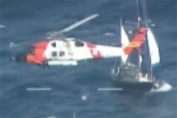 The Coast Guard hoists a man Tuesday, Dec. 15, 2015, after his sailboat became disabled approximately 60 miles off Cape Lookout, North Carolina. (U.S. Coast Guard video by Air Station Elizabeth City, North Carolina)