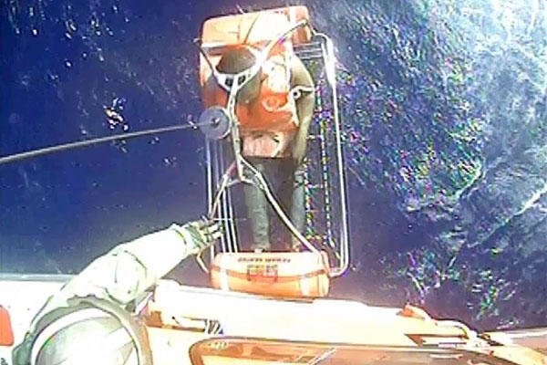 A Coast Guard helicopter rescues one of twelve crewmembers who abandoned ship in Cuban territorial seas Dec. 26, 2015. (U.S. Coast Guard)