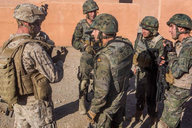 U.S. Marines with Special-Purpose Marine Air-Ground Task Force Crisis Response-Africa discuss lessons learned with Spanish Legionnaires during a military operations in urban terrain exercise, Dec. 15. (Photo: Staff Sgt. Vitaliy Rusavskiy)