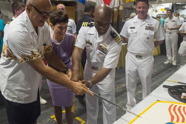 Fiji Pres. George Konrote, left, Ambassador Judith Cefkin, U.S. ambassador to Fiji, and Cmdr. Walter Mainor, commanding officer of USS William P. Lawrence, cut a cake during a reception. (Photo: Mass Communication Specialist 3rd Class Emiline L. M. Senn)