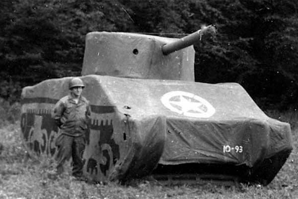A Ghost Army soldier with an inflatable M4 Sherman Tank, September 1944, France. (National Archives)