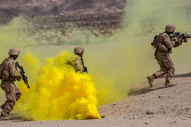 Marines with Company B, 3rd Light Armored Reconnaissance Battalion, run through smoke during a live-fire assault in the Combat Center training area at Twentynine Palms. (U.S. Marine Corps/Lance Cpl. Levi Schultz)