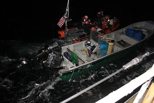 Coast Guard Cutter Escanaba's small boat crew tows an interdicted vessel during a patrol of the Eastern Pacific Ocean. (U.S. Coast Guard Photo)