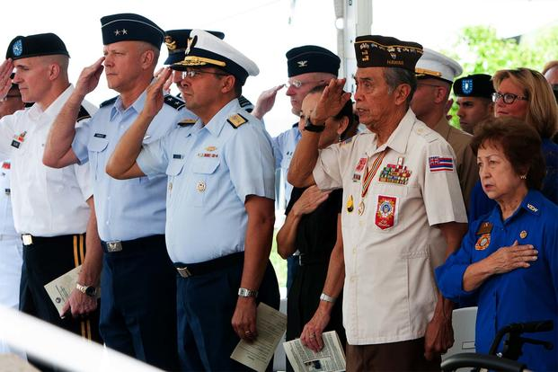 "Guests pay their respects during the National Anthem at ""Araw ng Kagitingan"" or Philippine Day of Valor, April 16, 2016, at the National Memorial Cemetery of the Pacific, Honolulu, Hawaii. (Photo courtesy of the Philippine Consulate General Honolulu)"