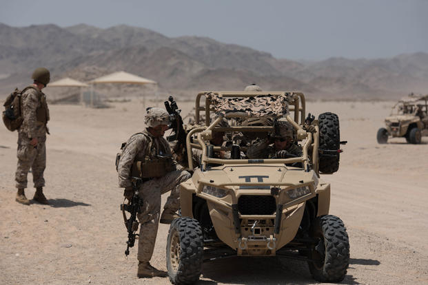 Members of 3rd Battalion, 5th Marines, mount up on the Polaris MRZR during Marine Integrated Experiment 2016 at Marine Corps Air Ground Combat Center Twentynine Palms, Calif., July 31, 2016. Sgt. Cuong Le/Marine Corps
