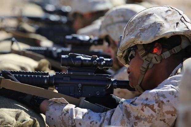 Lance Cpl. Falande Joachin fires the M4 Modular Weapon System during a zeroing exercise at Range 106, Marine Corps Air Ground Combat Center Twentynine Palms, California, Feb. 24, 2015. (U.S. Marine Corps/Sgt. Alicia R. Leaders)