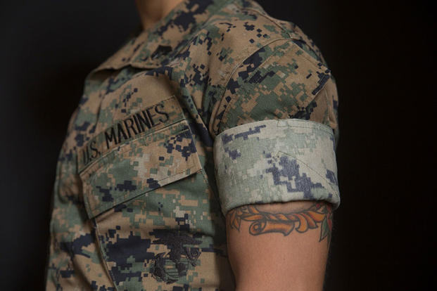 The Woodland Marine Pattern (MARPAT) Marine Corps Combat Utility Uniform (MCCUU) with the sleeves rolled up. Cpl. Adam Korolev/Marine Corps