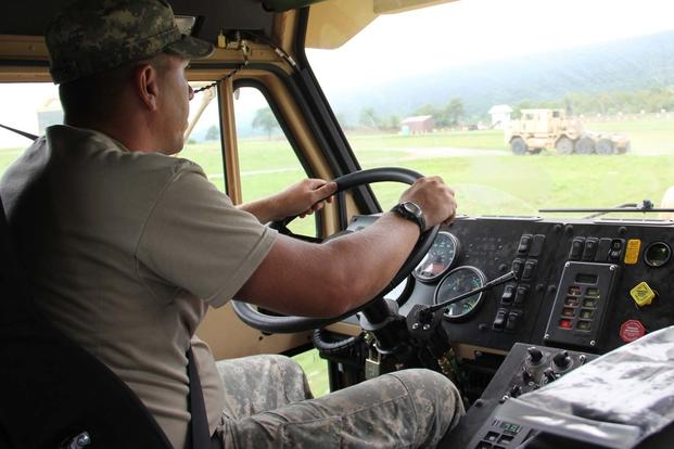Pfc. Ronald Carstetter, motor transport operator, 1067th Transportation Co., drives the M1070 Heavy Equipment Transporter on an off-road course on Aug. 10, 2016 at Fort Indiantown Gap, Pa. (U.S. Army National Guard/Sgt. Jason Fetterolf)