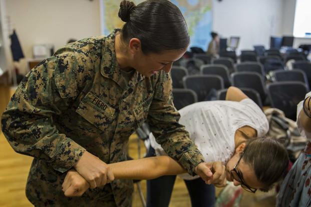 Women with a U.S. Marine Female Engagement Team operating in Europe interact with high school students at the National Library of Romania in Bucharest, 26 Sept., 2016. (U.S. Marine Corps/Sgt. Michelle Reif)