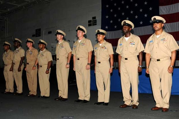 Nine newly frocked senior chief petty officers aboard USS GEORGE H.W. BUSH (CVN 77) are presented to the crew during a pinning ceremony in the ship's hangar bay. (U.S. Navy/Mass Communication Specialist 3rd Class Brent Thacker)