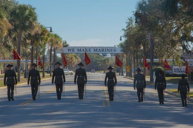 Drill instructors at Parris Island retire the guidons Dec. 2, 2016. (Marine Corps Photo)