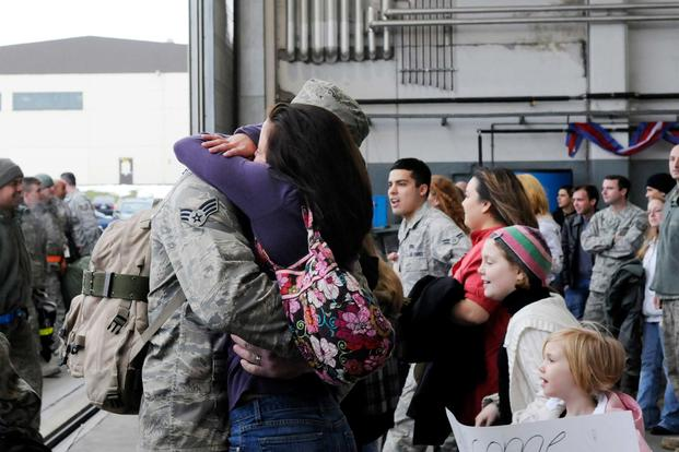 FILE --  An Airman greets his wife as family members rush to find their loved ones during a celebration for those returning home Feb. 5, 2010. (U.S. Air Force/Airman 1st Class Staci Miller)