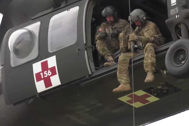 The Florida National Guard gets ready for Hurricane Irma. preparing high water vehicles and conducting hoist training with a UH-60 Black Hawk near Cecil Field, Jacksonville, FL. (Screen grab from Florida National Guard Video)