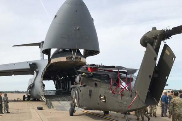 Soldiers with the 101st Combat Aviation Brigade, 101st Airborne Division (Air Assault) and Airmen with the 68th Airlift Squadron, 433rd Airlift Wing prepare an HH-60 medevac Blackhawk, Sept. 10, to load into a C-5M Super Galaxy. (Photo: U.S. Army)