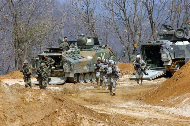FILE -- Soldiers from the 2nd Infantry Division and the Republic of Korea army participate in a combined live-fire event on Rodriquez Multi-purpose Live-fire Range Complex in Pocheon, South Korea, in 2011. (U.S. Army/Yu Huson)