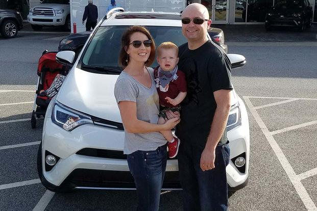 The Snell family with their new 2017 RAV4 SUV, provided by Toyota. The company chose to drop an appeal late last year over whether or not the family's 2013 RAV4 was covered under Georgia's lemon law. (Photo: Courtesy of Christina Snell.)