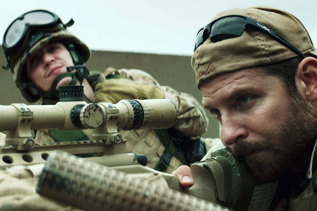 "In this image released by Warner Bros. Pictures, Kyle Gallner, left, and Bradley Cooper appear in a scene from ""American Sniper."""