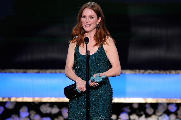 "In this Jan. 25, 2015 file photo, Julianne Moore accepts the award for outstanding performance by a female actor in a leading role for ""Still Alice"" at the 21st annual Screen Actors Guild Awards at the Shrine Auditorium in Los Angeles."