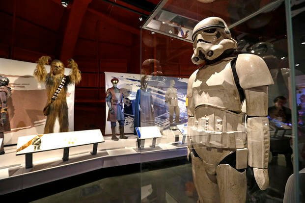 n this photo taken Thursday, Jan. 29, 2015, a stormtrooper costume is displayed in view of Chewbacca and military uniforms as part of an exhibit on the costumes of Star Wars at Seattle's EMP Museum.