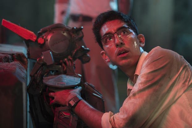 "This image released by Columbia Pictures shows Dev Patel in a scene from ""Chappie."" (AP Photo/Columbia Pictures, Stephanie Blomkamp)"
