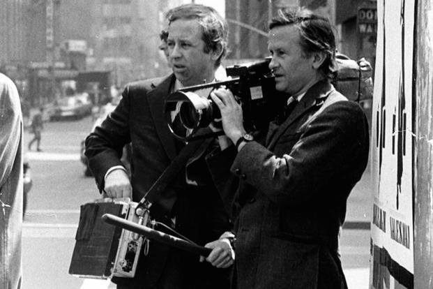 "In this July 1969 file photo, documentary filmmakers David, left, and Albert Maysles work on the streets of New York for ""Salesman."""
