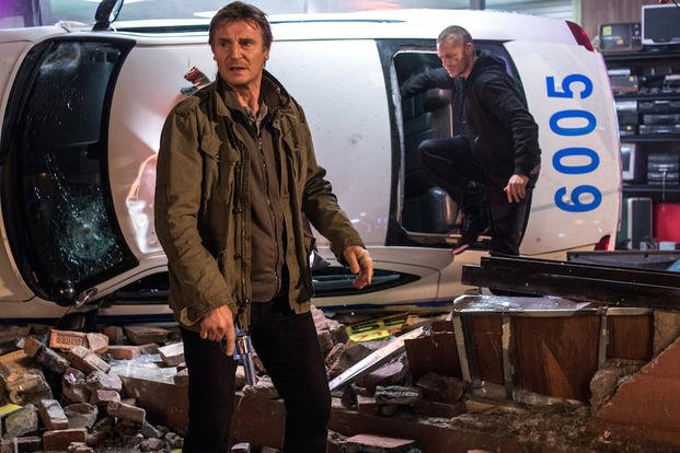 "In this image released by Warner Bros. Pictures, Joel Kinnaman and Liam Neeson, left, appear in a scene from ""Run All Night."" (AP Photo/Warner Bros. Pictures, Myles Aronowitz)"