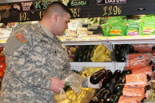 Soldier shopping at a commissary.