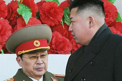 In this file photo, North Korean leader Kim Jong Un walks past his uncle Jang Song Thaek.