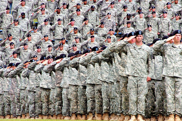 A sea of U.S. Army soldiers salute during the 1st Armored Division's 2nd Brigade uncasing ceremony held on Baumholder's Minick Field, Germany, June 5, 2009. Sgt. Brandon Moreno/Army photo