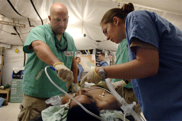 Air Force personnel care for a patient at Balad Air Base, Iraq in October 2006. (Air Force photo/Scott Wagers)