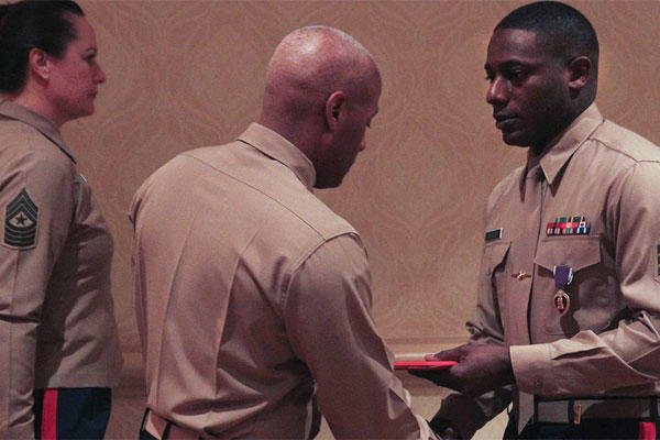 Marine Corps Sgt. DeMonte R. Cheeley receives the Purple Heart for injuries from a terrorist attack in Chattanooga, Tenn. on July 16, 2015. Five other servicemen were killed in the attack by a lone gunman. (Marine Corps photo)