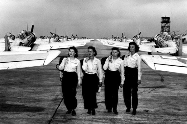 WASP pilots walk past lines of warplanes that they and more than 1,000 other women pilots would be delivering to points of departure for combat operations; 38 WASPs lost their lives in the line of duty. (US Air Force photo)