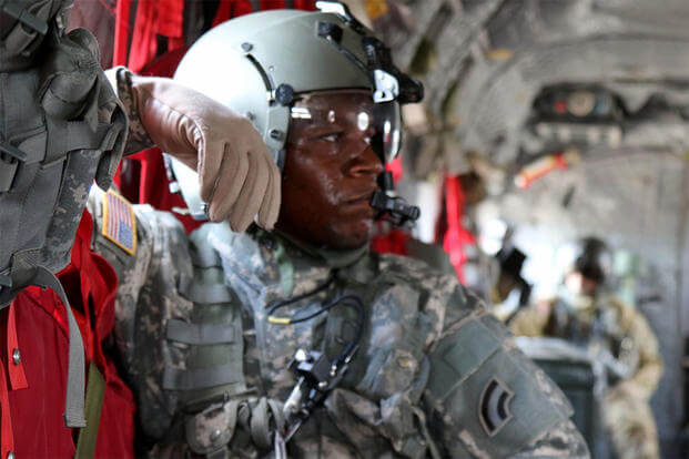 "Maryland National Guard's Sgt. DaShaun Hood, a CH-47 ""Chinook"" crew chief, monitors in-flight operations during a route familiarization exercise at the Fort Polk, Louisiana, July 13, 2016. (U.S. Army/Sgt. Michael Davis)"