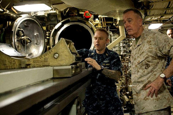 Marine Corps Gen. Joe Dunford, chairman of the Joint Chiefs of Staff, receives a briefing on the torpedo system on board the USS Alaska at Naval Submarine Base Kings Bay, Ga., on May 20. (DoD photo/D. Myles Cullen)