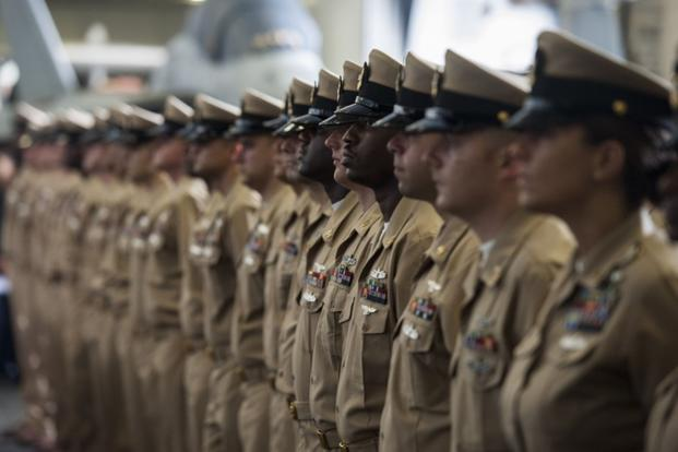 Chief petty officers stand at attention during a chief pinning ceremony aboard the aircraft carrier USS George H.W. Bush (CVN 77) on Sept. 16, 2016, in the Atlantic Ocean. (U.S. Navy photo/Christopher Gaines)