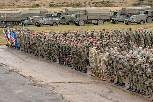 Troops from the U.S. Army, Armed Forces of the Slovak Republic, Czech Army, Polish Armed Forces and Hungarian Defense Forces stand in formation during the Slovak Shield 2016 opening ceremony Oct. 6, 2016, in the Slovak Republic. Courtesy photo