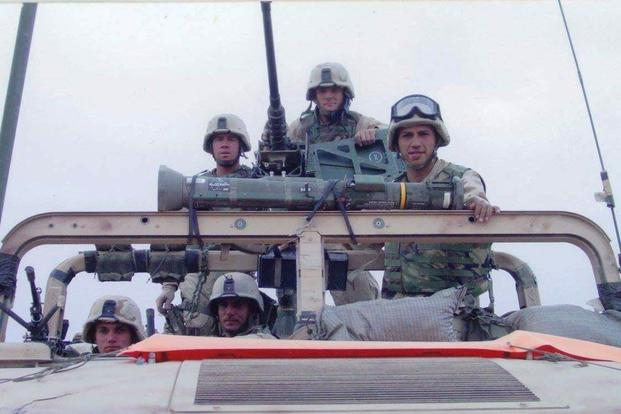 Jeffrey Carisalez, right, then a lance corporal and vehicle mechanic for Bravo Company, shown in a Humvee with fellow Marines in Iraq in 2003. (Photo courtesy Jeffrey Carisalez)