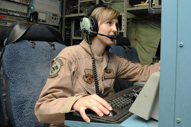 Senior Airman Whitni Orgass, 41st Expeditionary Electronic Combat Squadron cryptological language analyst, works at her station aboard an EC-130 Compass Call aircraft on Bagram Airfield, Afghanistan. (U.S. Air Force photo by Staff Sgt. David Dobrydney)
